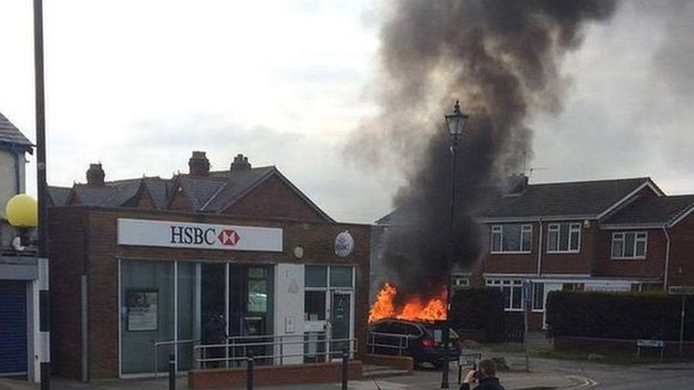 car on fire next to HSBC bank