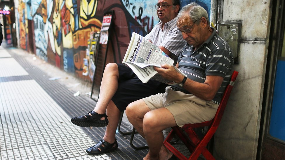 Man reads a newspaper in the Argentine capital Buenos Aires.