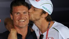 David Coulthard and Jenson Button share a kiss