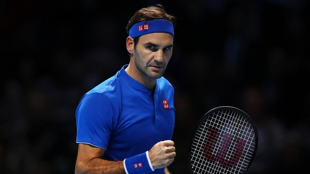 Roger Federer beats Kevin Anderson to top group at ATP Finals in London