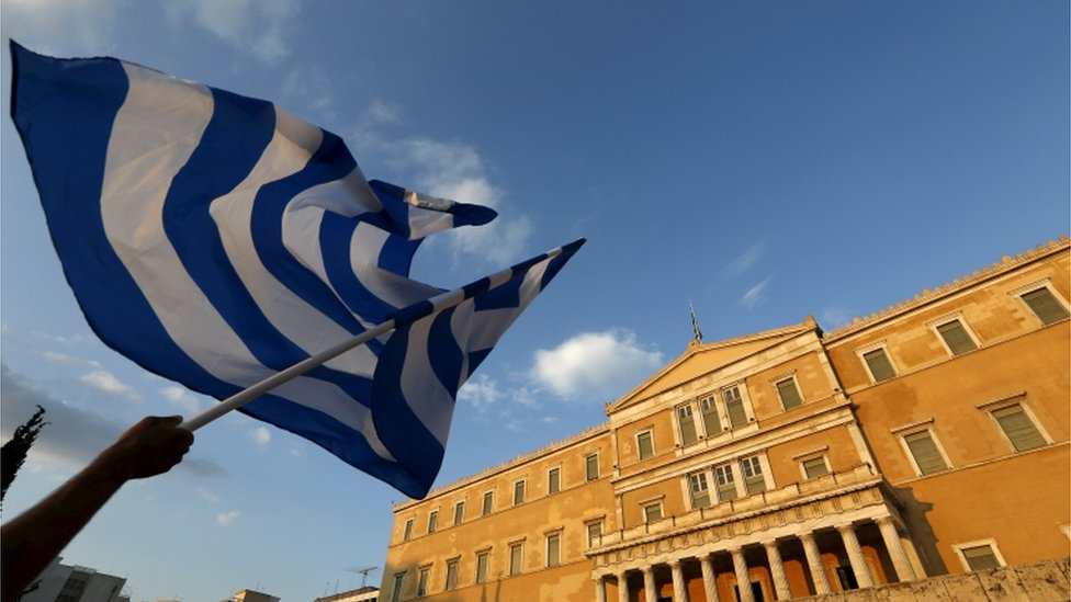 The Greek government is in last-minute talks over whether to accept an offer that would let Greece repay part of its debt, local media say.
