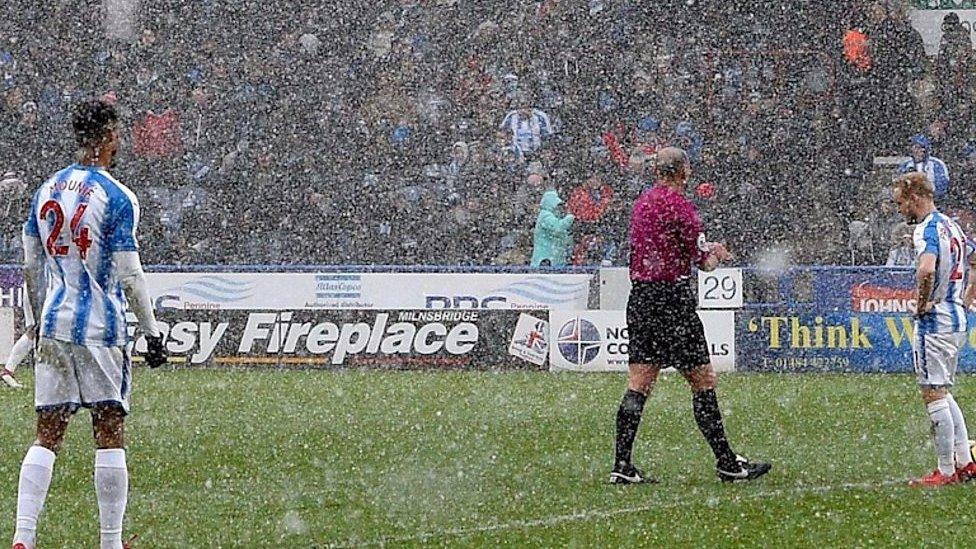 Snow storms hit Premier League grounds