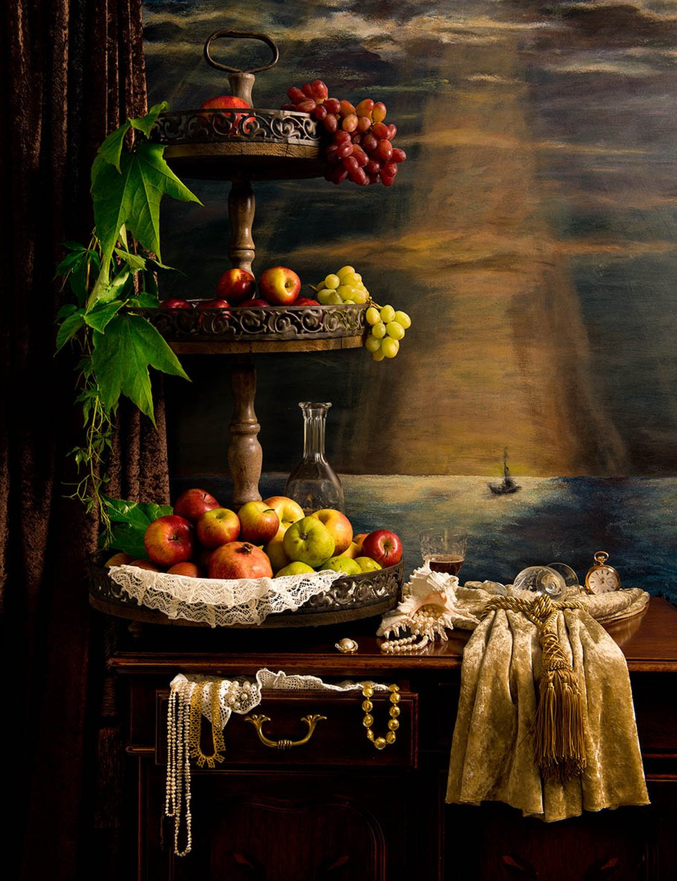 A wooden stand covered in fruit in front of a painting of a ship at sea