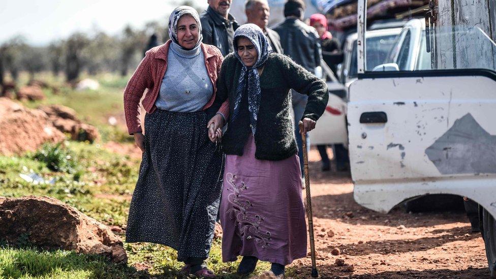 Syria war: 'Civilians killed' as thousands flee Turkish air strikes
