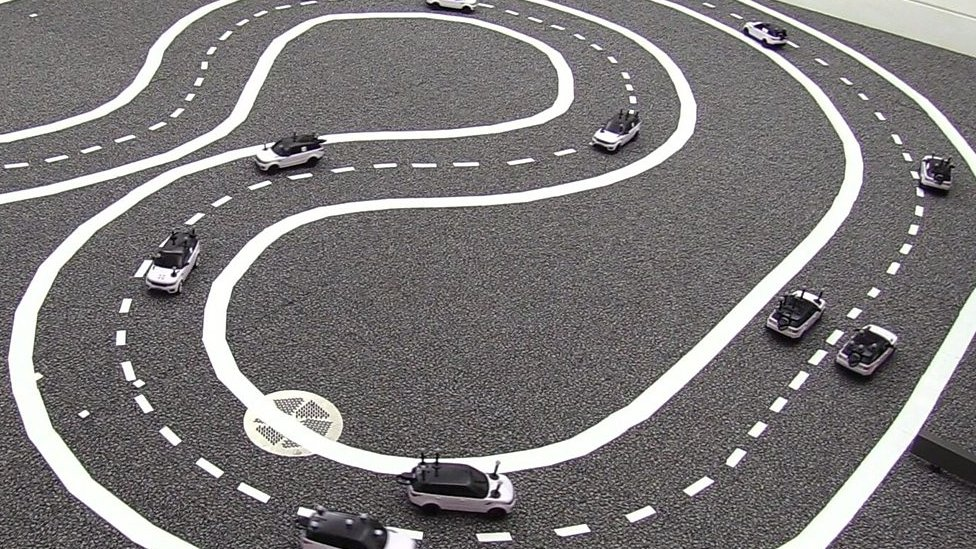 Driverless cars: Cambridge University model cars 'talk' to avoid jams
