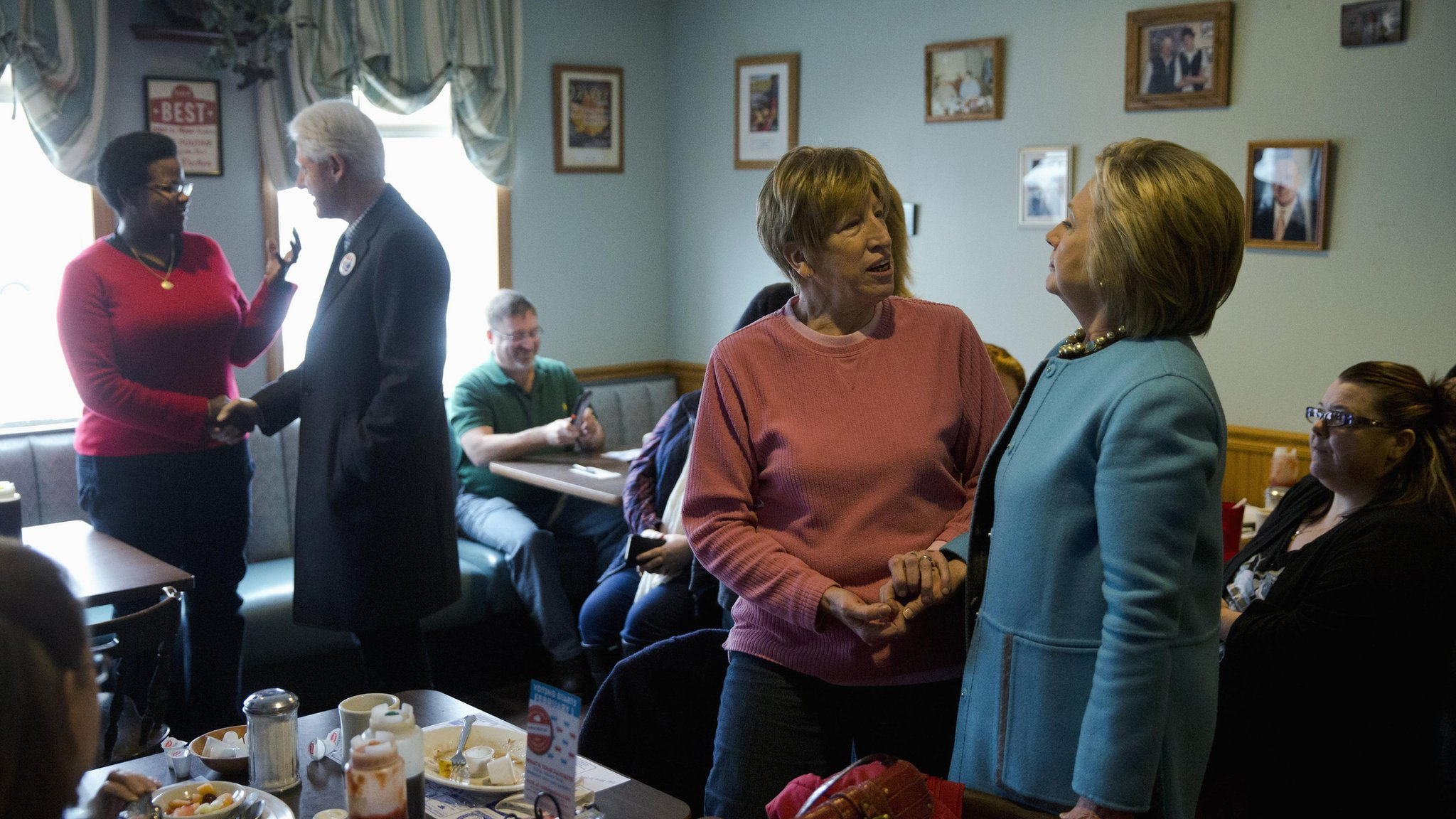 Hillary and Bill Clinton meet voters in a New Hampshire diner