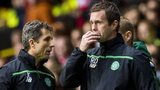 Celtic assistant John Collins and manager Ronny Deila look concerned