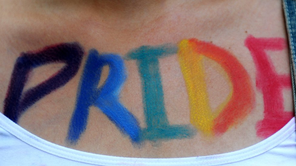 A woman takes part in Turkey's Gay Pride parade with the word 'Pride' painted on her body
