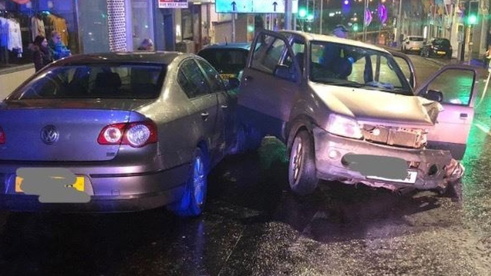 Two arrested after six cars struck in Bangor