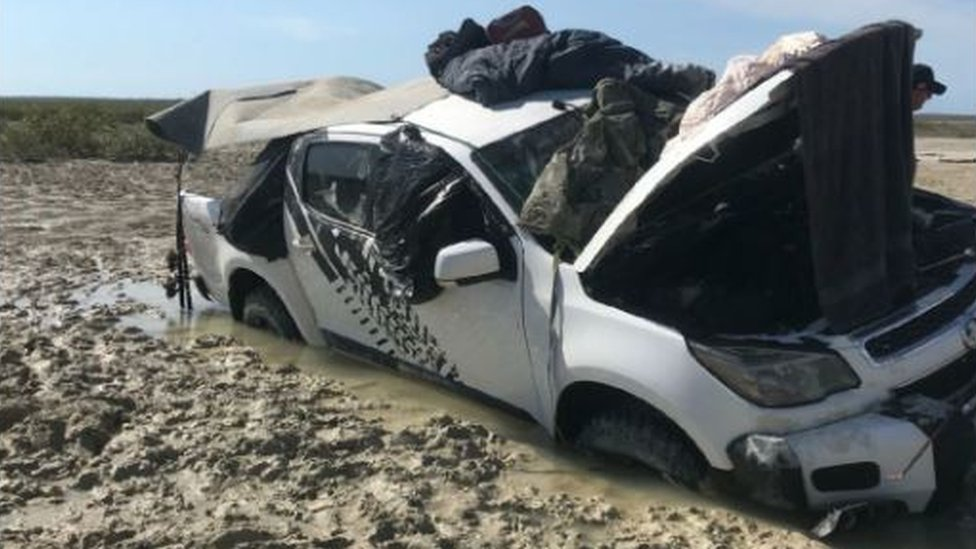 Australian men forced on to car roof to escape crocodiles