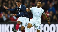 Anthony Martial of France and Nathaniel Clyne of England compete for the ball during the International Friendly match between England and France at Wembley Stadium on 17 November 2015 in London, England