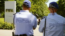 Swiss police officers stand in front of the entrance of the FIFA headquarters in Zurich, Switzerland on 3 June