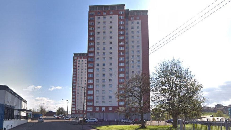 Woman dies after falling 11 floors from Glasgow flats