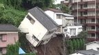 Japanese house toppling over following mudslide