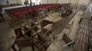 Upturned chairs and blood stains the floor at the Army Public School auditorium the day after Taliban gunmen stormed the school in Peshawar - 17 December 2014
