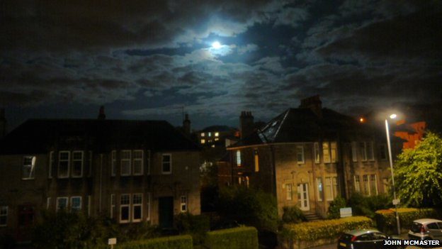 A blue moon looms over a Glasgow suburb
