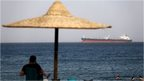 The beach in El Ain El Sokhna port as an Egyptian crude oil tanker on its way to the Suez canal
