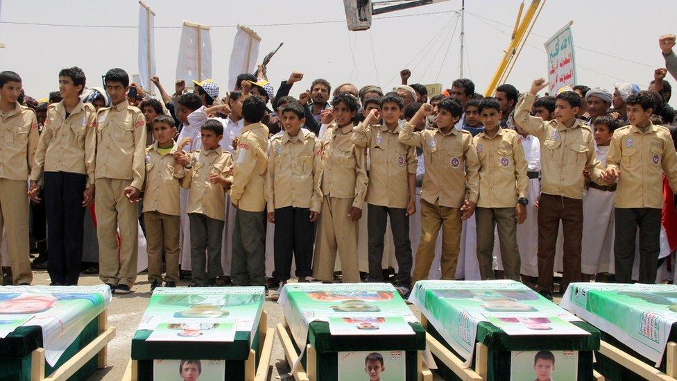 Yemen war: Mass funeral held for children killed in bus attack