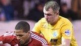 Larne striker Guillaume Keke battles with Ballymena's Johnny Taylor at Inver Park