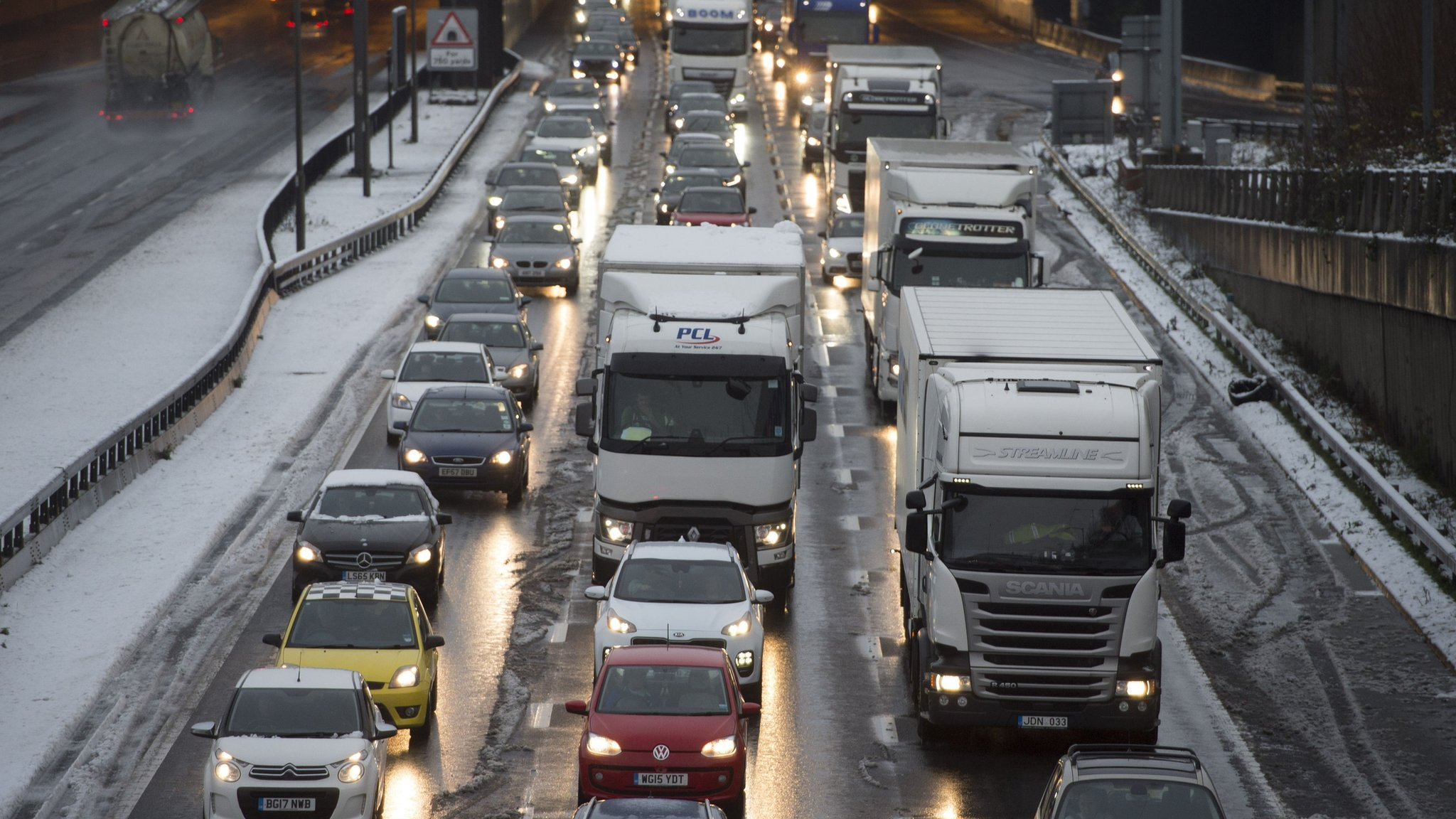 UK snow: Widespread travel delays and school closures