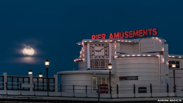 A blue moon rise over the pier in Worthing