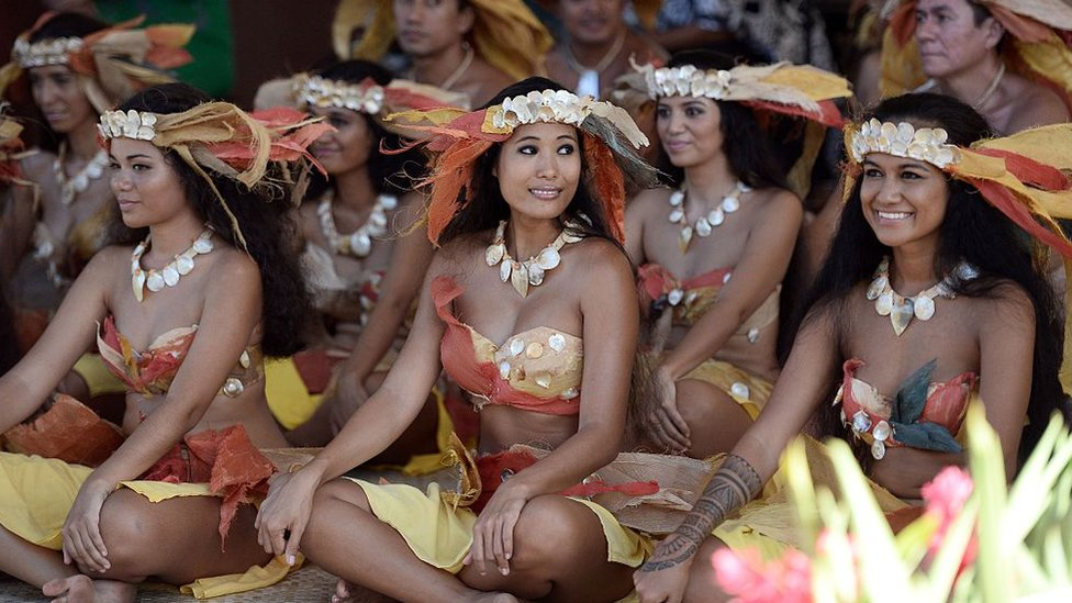 Dancers in traditional costume at an event in Papeete