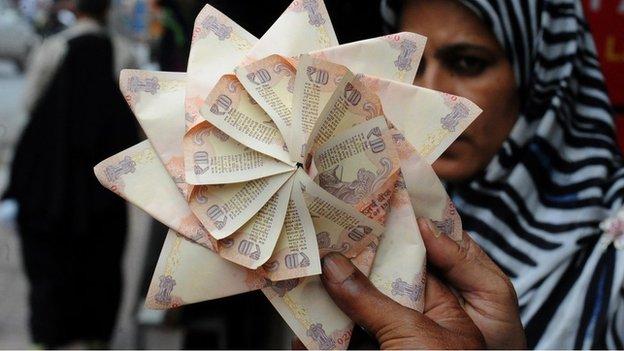 Rupee notes in a fan
