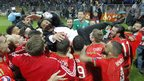 Wales' head coach Chris Coleman celebrates with players after  qualifying for Euro 2016 at the Stadium Bilino Polje in Elbasan.