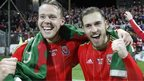 Chris Gunter (l) and Aaron Ramsey celebrate after the match