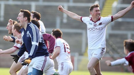 Slaughtneil players celebrate at the final whistle