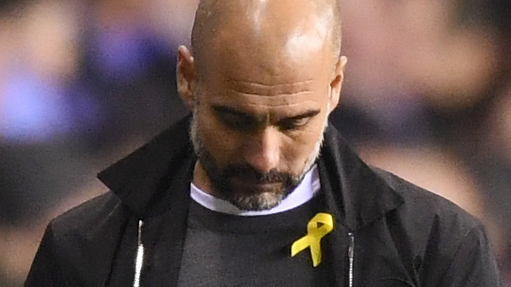 Guardiola charged for wearing political ribbon