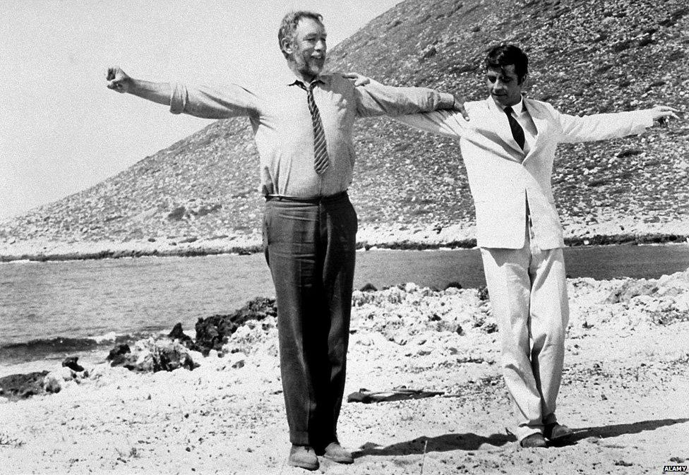 Zorba (Anthony Quinn) teaches Basil (Alan Bates) to dance sirtaki