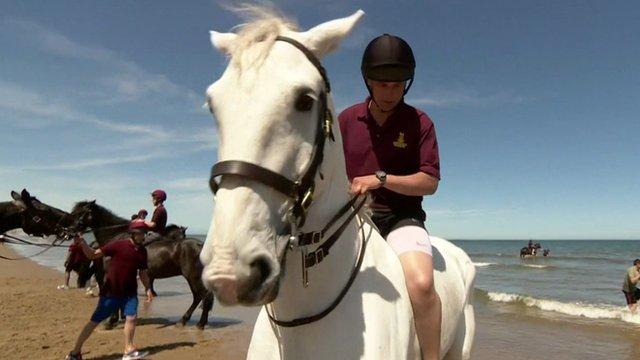 VIDEO: Sea horses: Household Cavalry at beach...