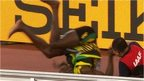 VIDEO: Bolt wiped out by cameraman