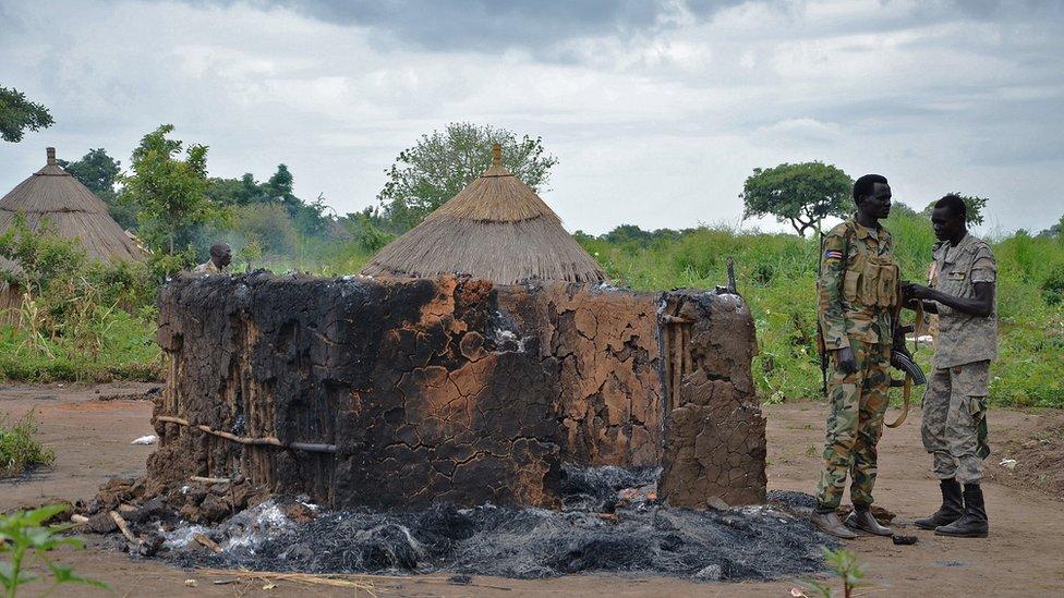 Soldiers in a war-hit village