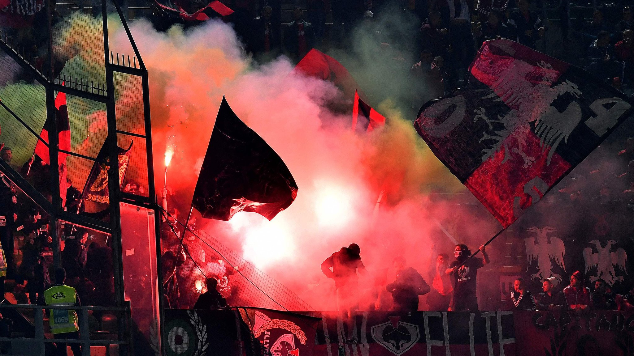 Flares force game to be suspended as Italy win in Buffon's 1000th match
