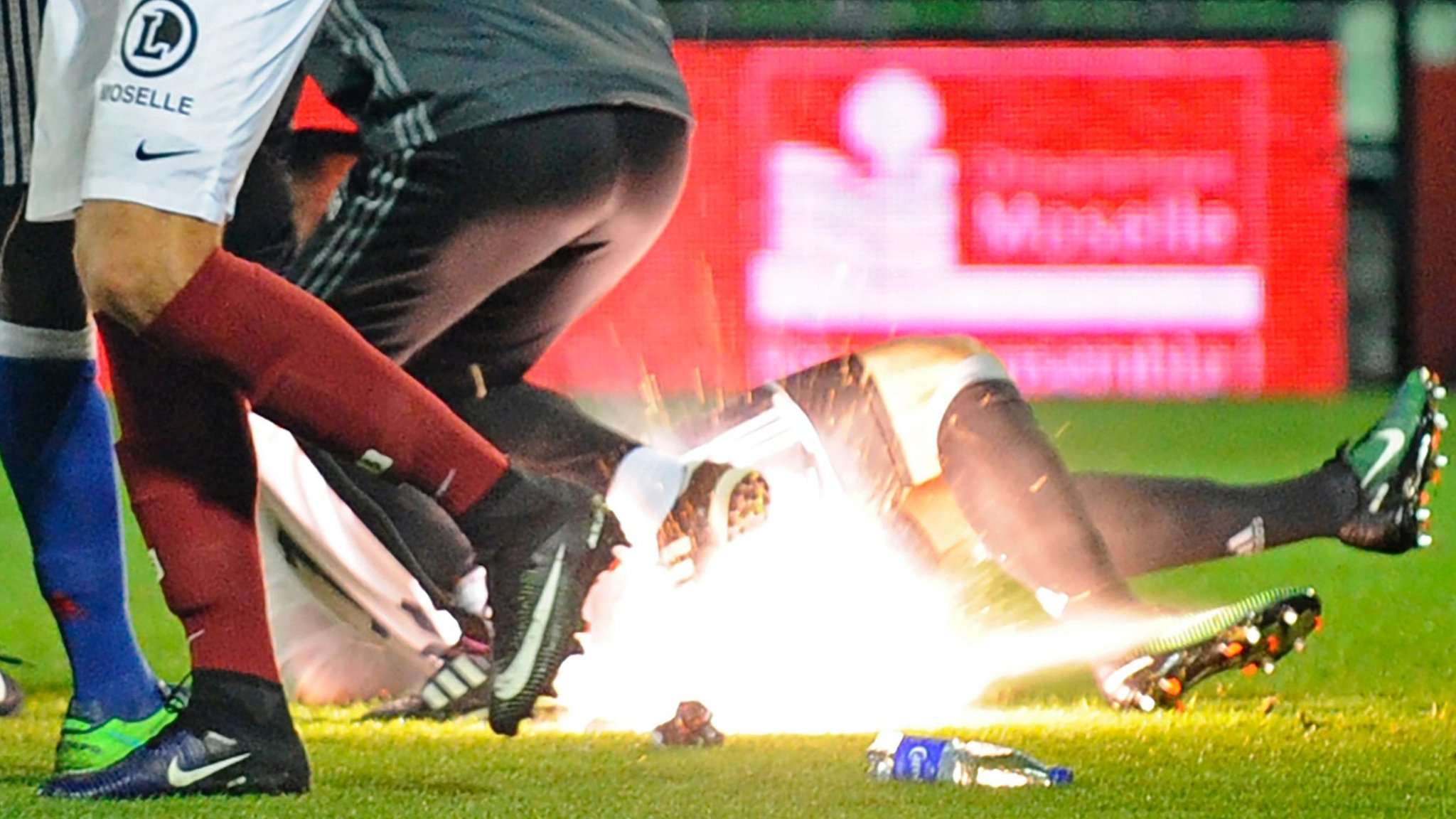 French game off after firecrackers thrown at keeper