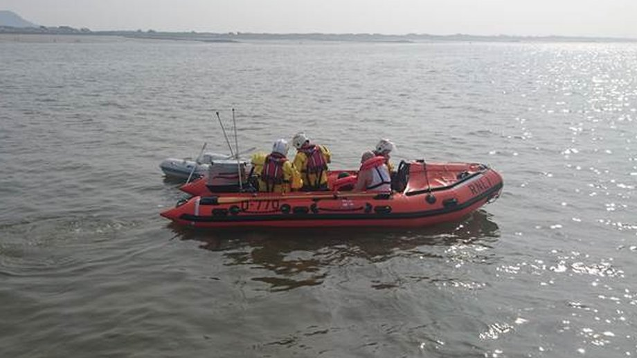 Father and son rescued from dinghy heading to wind farm