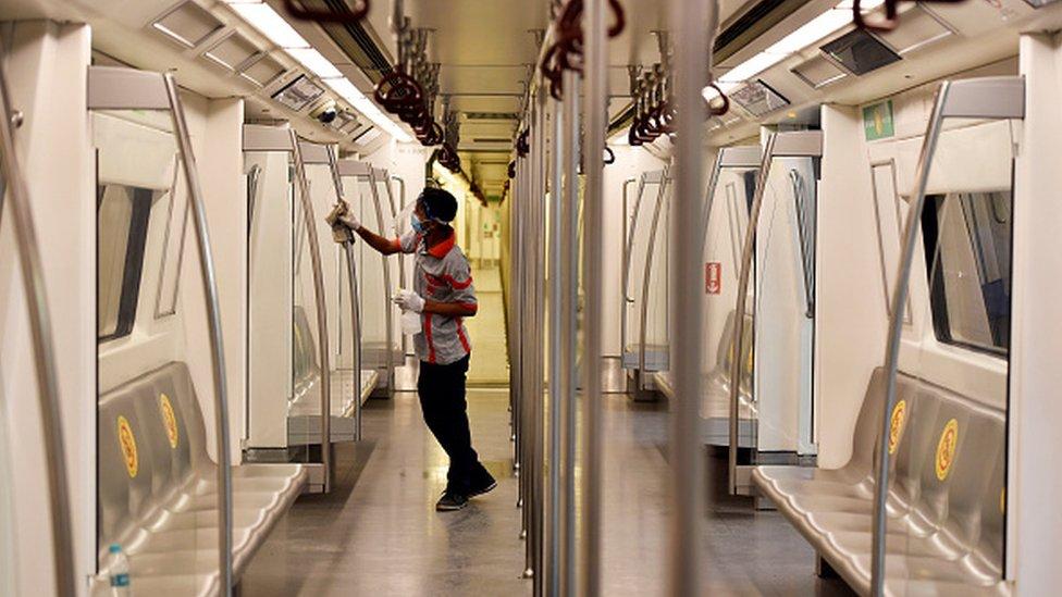 A worker sanitises a metro coach at Rajiv Chowk Metro Station