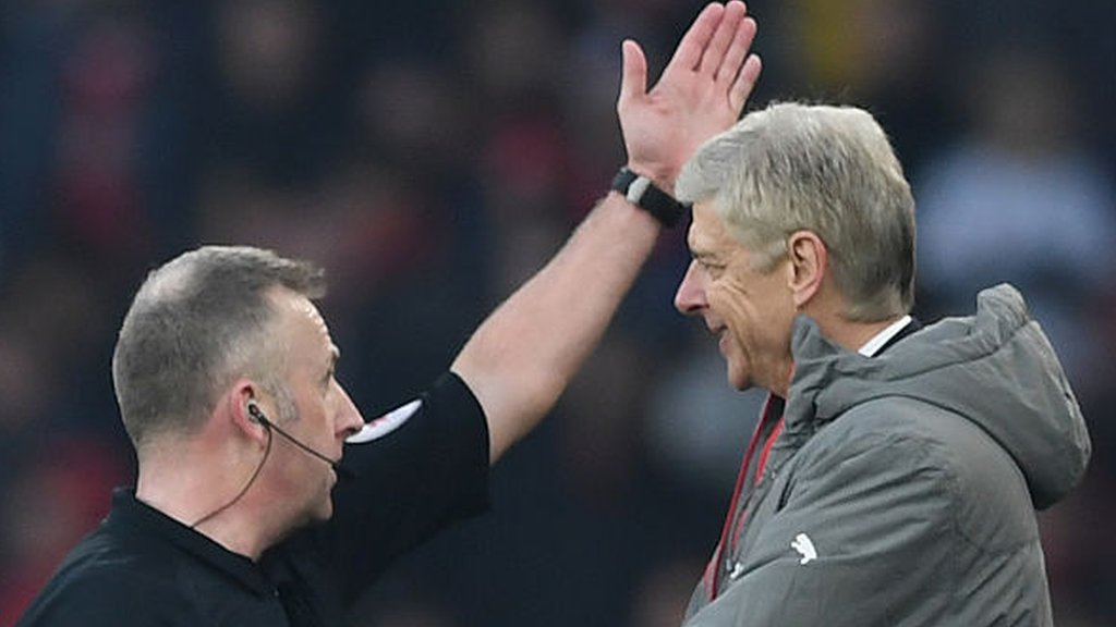 Arsenal boss Wenger sorry after clash with official