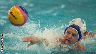 Older man plays water polo