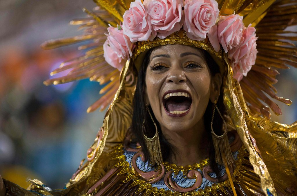 """A reveller of the Beija-Flor samba school performs during the second night of Rio""""s Carnival at the Sambadrome in Rio de Janeiro, Brazil, on February 13, 2018. / AFP PHOTO / Mauro PIMENTELMAURO PIMENTEL/AFP/Getty Images"""