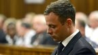 Oscar Pistorius sits in the dock of the court in Pretoria, October 21st 2014