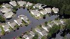 An aerial photograph of a flooded neighbourhood