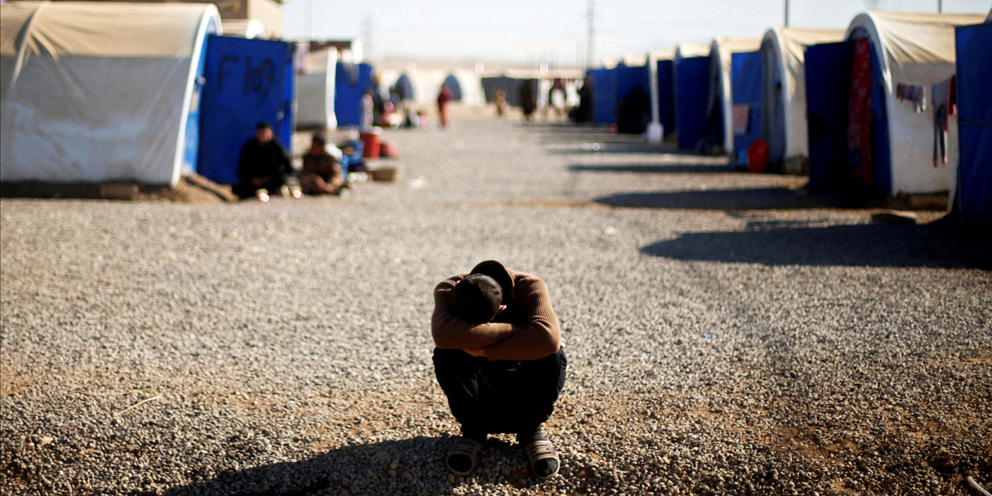 Boy in a displacement camp outside Mosul
