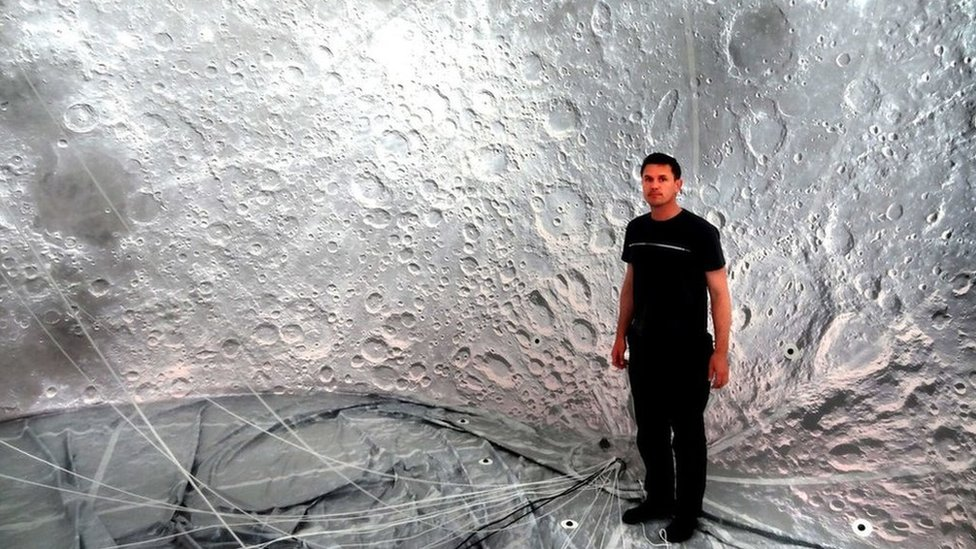 Giant moon artwork goes missing in post on way to Austria