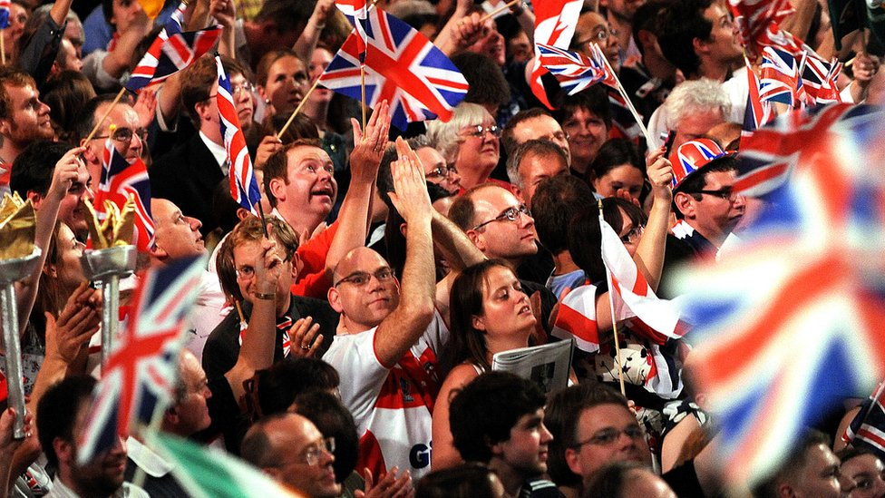 The crowd waves flags at the Last Night of the Proms