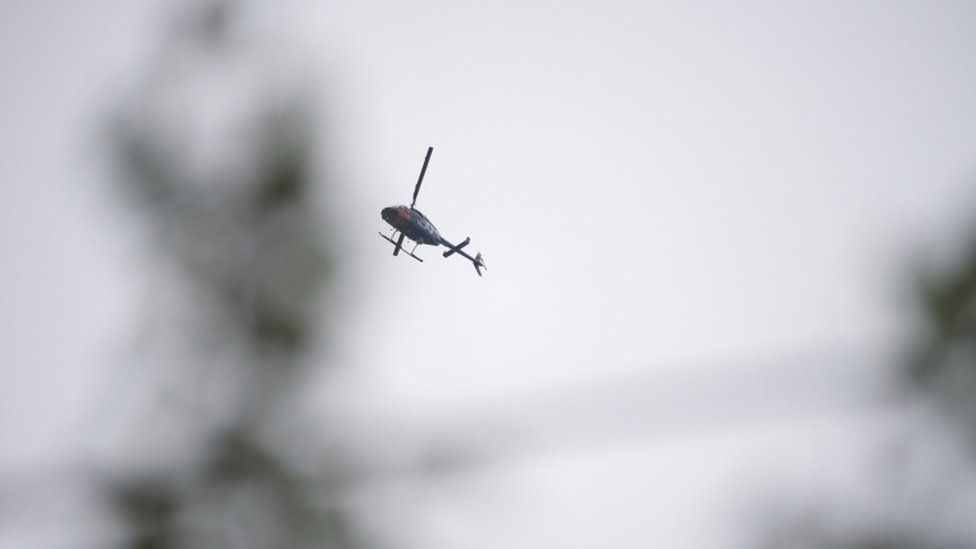 News helicopters hover of the courthouse