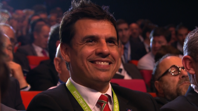 Wales manager Chris Coleman reacts after Wales are drawn with England at Euro 2016