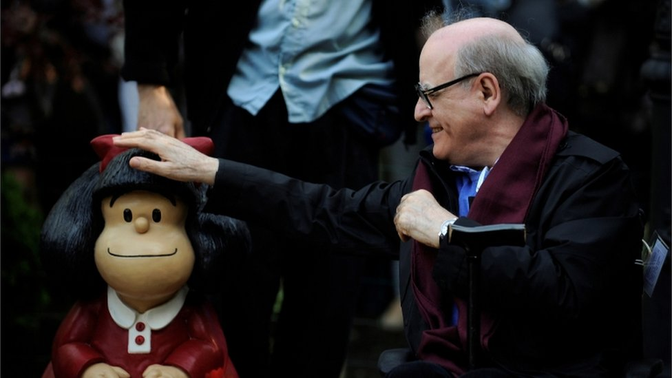 Cartoonist Joaquin Salvador Lavado, also known as Quino, touches a sculpture of his comic character Mafalda, during an opening ceremony of a park of San Francisco in Oviedo, northern Spain, October 23, 2014